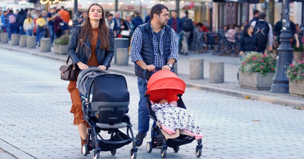 A Couple walking with Best Lightweight Jogging Stroller